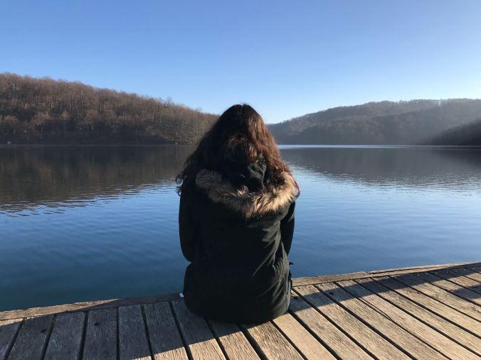 me sitting on edge of walkway overlooking lake