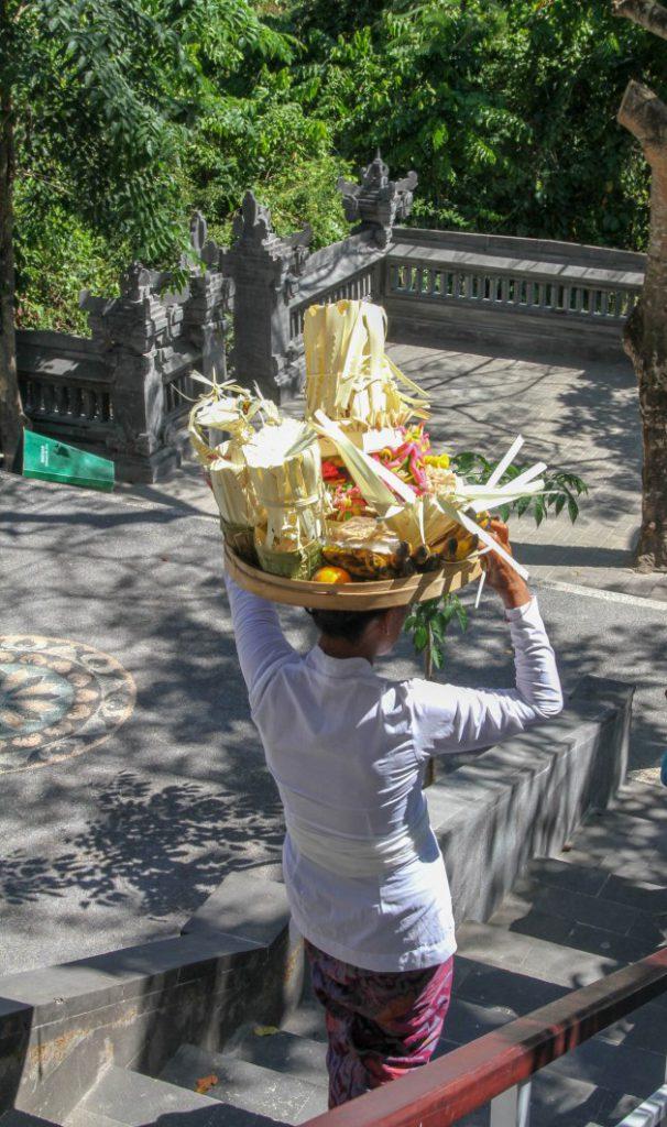 Man carries offerings on head