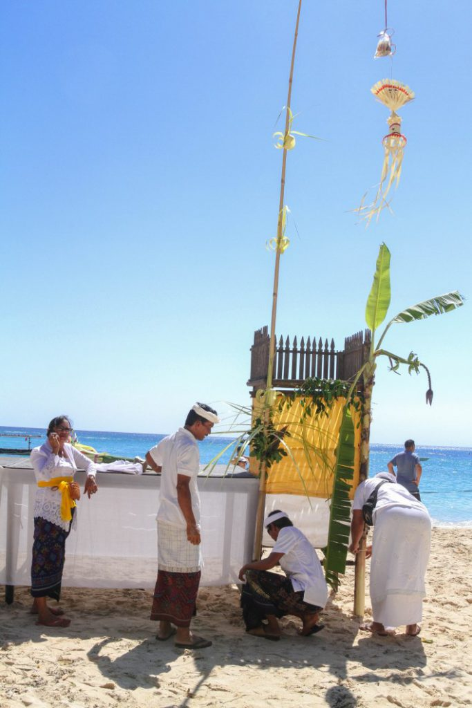 Preparing for ceremony on the beach